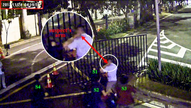 STABBED IN THE NECK. This is the exact moment when one of the 4 suspects brings his hand close the victim's neck. The victim is already bleeding in the next fragment of the CCTV video. Photo from case file