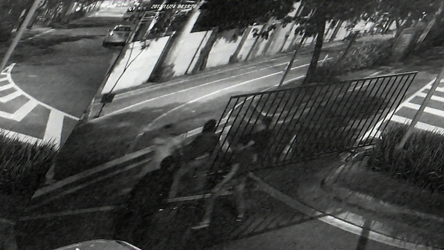 ANALYZE THIS. The CCTV footage shows the moment when one or two of the suspects stab Anikow with a tactical knife in front of the Rockwell security checkpoint beside the Bel-Air gate in Makati. Screenshot from video courtesy of the Makati police