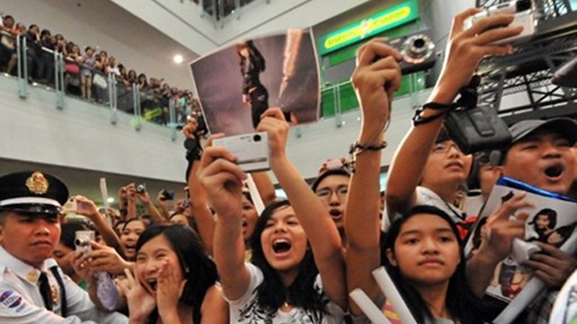 BEYOND SHOPPING. Malls now offer the 'total experience' rather than just shopping to Filipinos. This photo shows screaming fans in a mall concert of a popular foreign artist. Photo courtesy of AFP.
