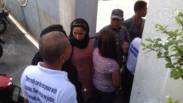 HAPPY BUT ANNOYED. Mangudadatu family members come out of the courtroom in Taguig. Photo by Rupert Ambil