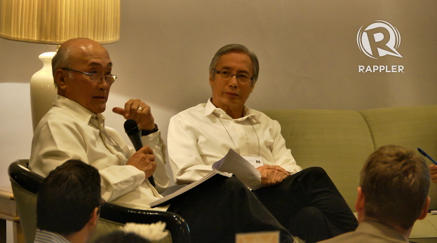 CONFLICTING IDEAS. Economists Gerardo Sicat (left) and Felipe Medalla (right) disagree on how powerful the president should be in order to push forward economic growth. Photo by Franz Lopez.