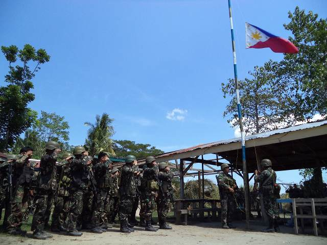 FIGHTING OVER. The Philippine flag is raised in the main BIFF lair in Barangay Ganta, Shariff Saydona Mustapha, Maguindanao after government troops seized it on January 31, 2014. Photo from the Armed Forces of the Philippines.
