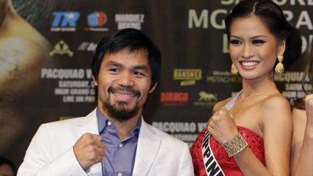 #PINOYPRIDE IN VEGAS. Cong Manny Pacquiao and Ms Philippines Janine Tugonon raise their fists to show that they are ready for their respective 'fights' this December. Photo from the Janine Mari Raymundo Tugonon Facebook page