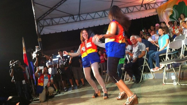 HARLEM SHAKE. Zambales Rep Mitos Magsaysay gamely does the Harlem Shake dance with actress Alma Concepcion. Photo by Ayee Macaraig