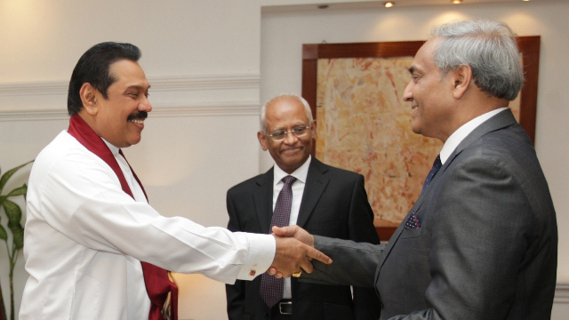 APPOINTED. President Mahinda Rajapakse (left) shakes hands with Mohan Peiris after appointing him chief justice on January 15. Photo from AFP
