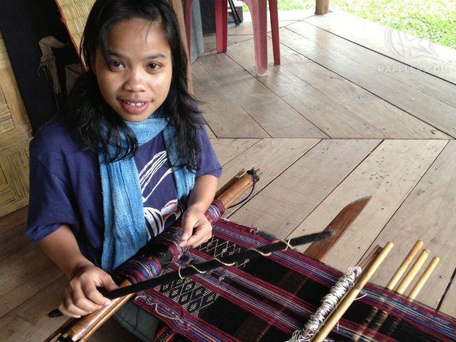 NEXT GENERATION. Weavers at Ock Pop Tock, like Mone (pictured), help carry on the tradition and benefit economically from sales