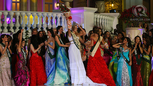 Miss Czech Republic held on to her crown to keep it from falling off because of the wind