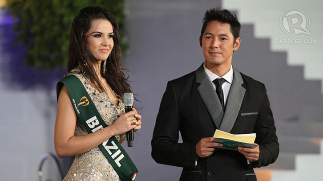 Miss Brazil listens to the question: What would you consider is your defining moment as a woman?