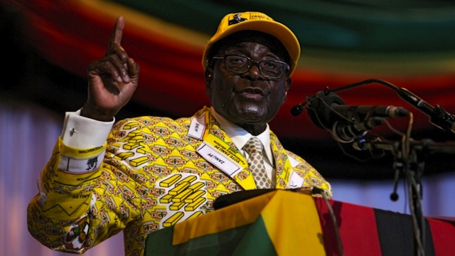 STRONGMAN. Zimbabwe president and leader of Zimbabwe African National Union-Patriotic Front (ZANU-PF) Robert Mugabe delivers a speech at his party's annual national conference in Gweru, on December 7, 2012. AFP/PHOTO JEKESAI NJIKIZANA