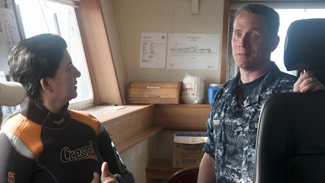PH, US COOPERATION. US Navy supervisor of salvage Capt Mark Matthews (R), on-scene commander for the salvage of the USS Guardian, speaks with park superintendent Angelique Songco aboard the SMIT Borneo. Photo courtesy of US Navy