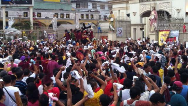 FAITH AMONG FRENZY. Devotees crowd the Plaza Miranda as they await the Black Nazarene's arrival. Photo by Devon Wong