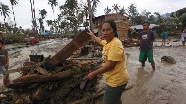 DAMAGE. A resident of New Bataan, Compostela Valley tries to salvage scrap wood from debris caused by typhoon Pablo (Bopha), December 5, 2012. Photo by Karlos Manlupig.