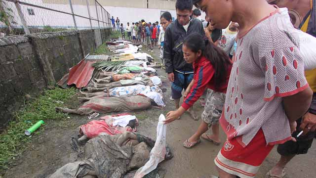 CASUALTIES. Bodies lie outside the municipal gymnasium of New Bataan, Compostela Valley, as residents search for their loved ones, December 5, 2012. Photo by Karlos Manlupig.