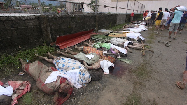 TRAGEDY IN COMPOSTELA VALLEY. Families struggle to identify their dead in New Bataan. Photo by Karlos Manlupig