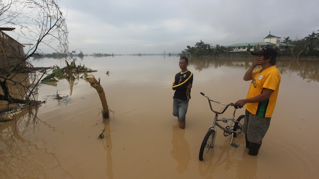 UNDER WATER. Entire parts of Compostela Valley are still submerged a day after the typhoon make landfall in nearby Davao Oriental province. Photo by Karlos Manlupig