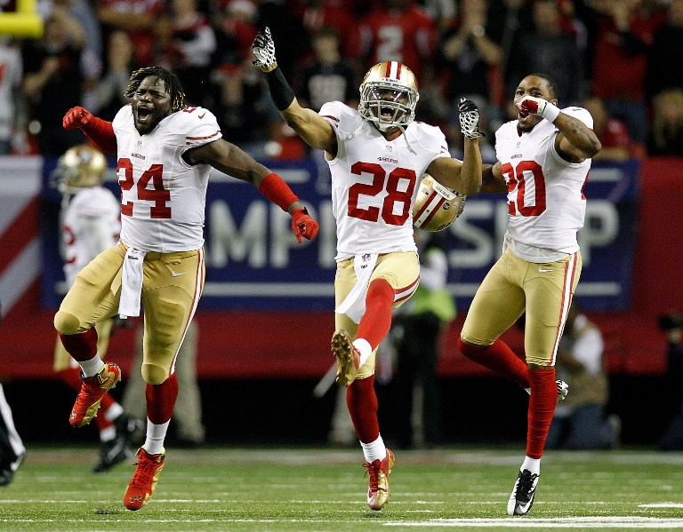 JUMP FOR JOY. Anthony Dixon #24, defensive back Darcel McBath #28 and defensive back Perrish Cox #20 of the San Francisco 49ers react after stopping the Atlanta Falcons on fourth down in the fourth quarter in the NFC Championship game at the Georgia Dome on January 20, 2013 in Atlanta, Georgia. Chris Graythen/Getty Images/AFP