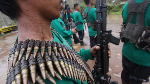 SHOW OF FORCE. New People's Army rebels in Compostela Valley. File photo by Karlos Manlupig