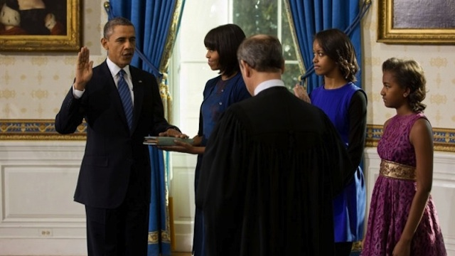 SECOND TERM. US Supreme Court Chief Justice John Roberts administers the oath of office to President Barack Obama during the official swearing-in ceremony in the Blue Room of the White House on Inauguration Day, Sunday, Jan 20, 2013. First Lady Michelle Obama, holding the Robinson family Bible, along with daughters Malia and Sasha, stand with the President. (Official White House Photo by Lawrence Jackson)