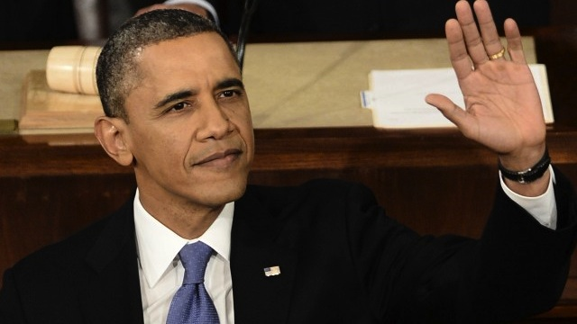 STATE OF THE UNION. US President Barack Obama waves before delivering his annual State of the Union address to a joint session of Congress at the US Capitol on February 12, 2013, in Washington. AFP PHOTO/Paul J. Richards