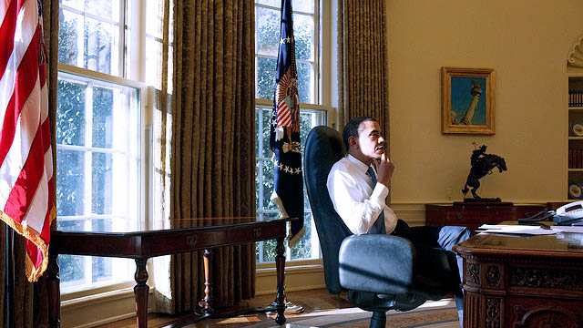 President Barack Obama sits in the Oval Office on his first day in office, back in Jan. 21, 2009. (Official White House Photo by Pete Souza)