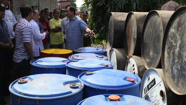 OIL SMUGGLING ON THE RISE. Local officials seize a cargo of smuggled oil products in San Fernando, La Union. Photo courtesy of www.sanfernandocity.gov.ph
