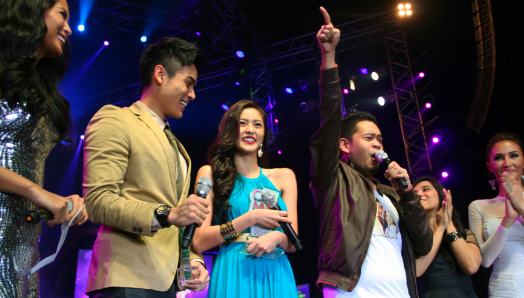 FAN CLUB OF THE YEAR KimXi representatives onstage with their idols