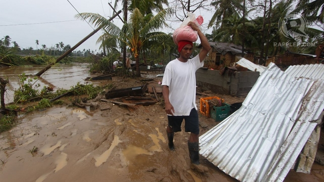 RESIDENTS HIT. Over 50,000 flee their homes due to Typhoon Pablo. Photo by Karlos Manlupig