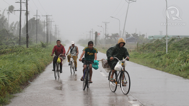 "TERRIFYING STORM. Residents flee their homes from typhoon ""Pablo."" Photo by Jef Maitem"