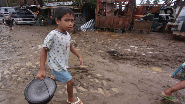 "DESTITUTE. Many children are among the survivors of typhoon ""Pablo"" and have been left with nothing. Photo by Karlos Manlupig"