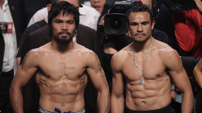 ROUND 4. Manny Pacquiao and Juan Manuel Marquez pose during their weigh-in December 7, 2012 in Las Vegas, Nevada. File photo by AFP/John GURZINSKI