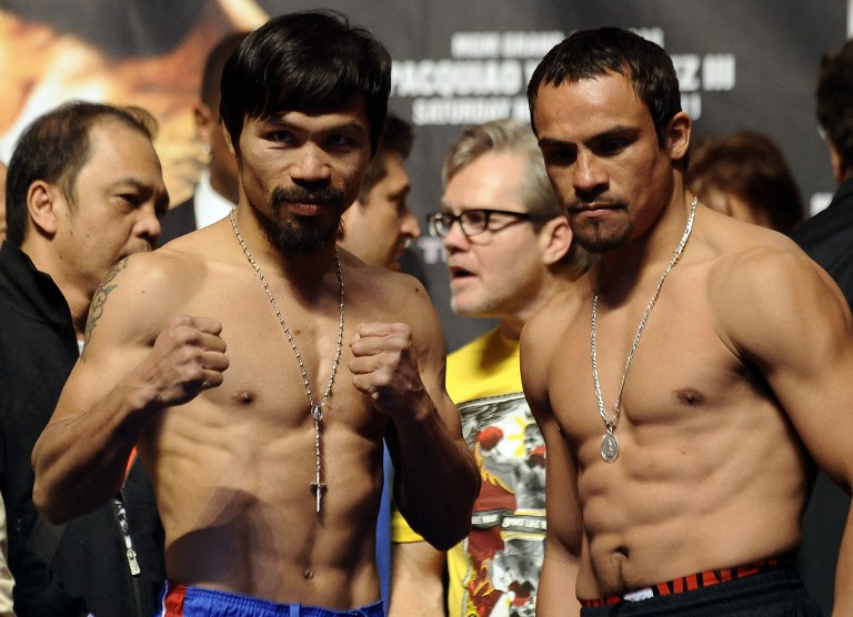ALWAYS CLOSE. Manny Pacquiao escaped with a majority decision win over Juan Manuel Marquez in their last fight together. (AFP FILE PHOTO)