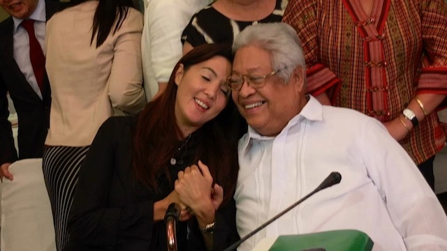 FINALLY. The principal sponsors of the Reproductive Health Bill in the Senate and the House, Sen Pia Cayetano and Albay Rep Edcel Lagman, share a light moment after the bicam signed the final version of the RH Bill. Photo from Cayetano's Facebook account
