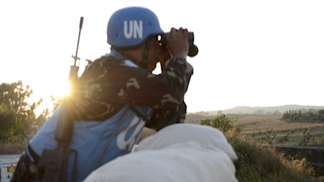 WORTH THE RISK. Filipino peacekeepers in Golan Heights face the daily dangers, like land mines, unfriendly fire and abduction but Ecarma says the risk is worth it. Photo by Frank Sayson.