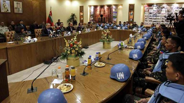 The UN peacekeepers attend a press conference after their release on the Syria-Jordan border at the Jordanian army headquarters (AFP PHOTO KHALIL MAZRAAWI)