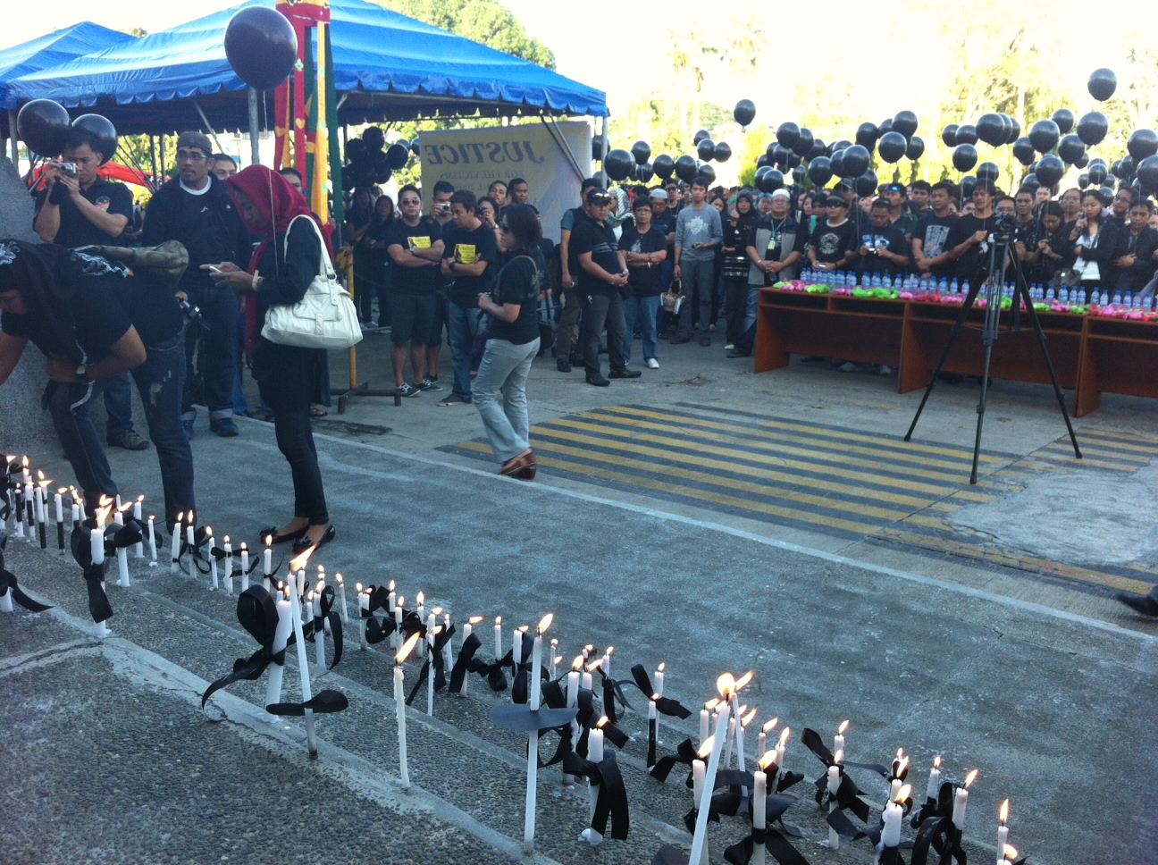 REMEMBERING THE DEAD. Media men and government employees in ARMM gather to remember the victims of the Maguindanao massacre. Photo by Ferdinandh Cabrera.