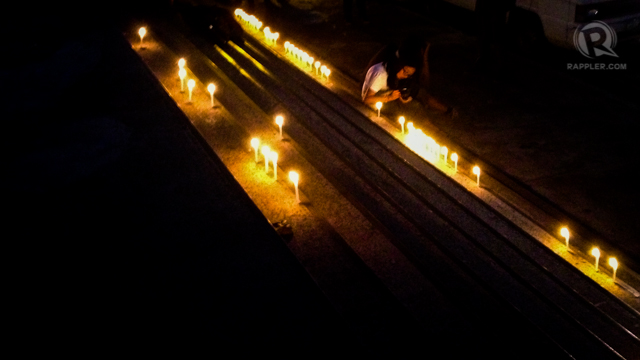VIGIL. UP students hold a simple memorial for fellow-student, Lorena. Photo by Paige Occeñola