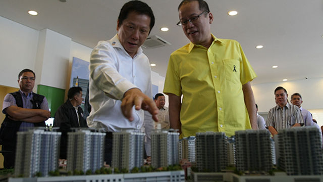 President Benigno S. Aquino III looks at the Mactan Newtown scale model presented by Megaworld Corp. chairman and chief executive officer Andrew Tan during the Mactan Newtown Grand Launch.