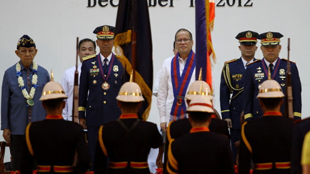 CHANGE OF LEADERSHIP. President Benigno S. Aquino III looks on the entry of colors during the Philippine National Police (PNP) Change of Command Ceremony with incoming chief Alan Purisima and outgoing head Nicanor Bartolome. Photo by Malacanang Photo Bureau.