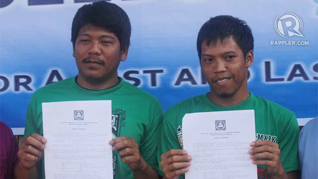 FREE AT LAST. PO1 Ruel Pasion (left) and Pfc Jezreel Culango show their order of release from the custodial unit of the NPA in Laak town on Thursday, February 21. Photo by Karlos Manlupig