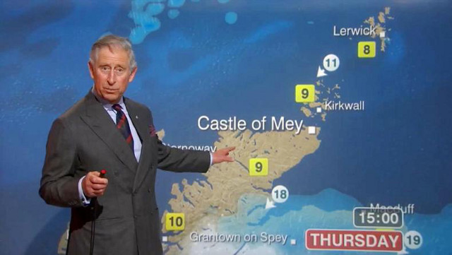 HE RAINS -- ER -- REIGNS SUPREME. Prince Charles doing the weather report for BBC in May 2012. Photo from the Prince Charles Facebook page