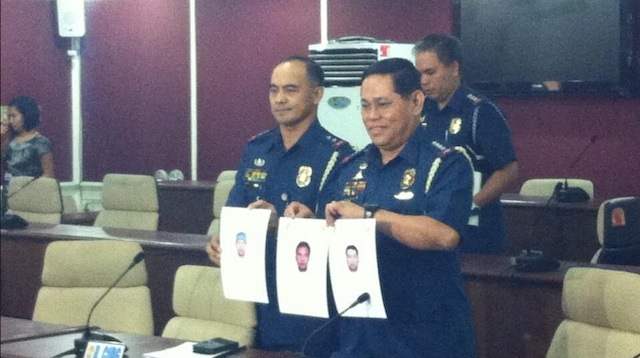 PROBABLE SUSPECTS. Philippine National Police Chief Alan Purisima shows media composite sketches of suspects in Cagayan de Oro City blast based on witnesses' testimonies. Photo by Natashya Gutierrez/Rappler