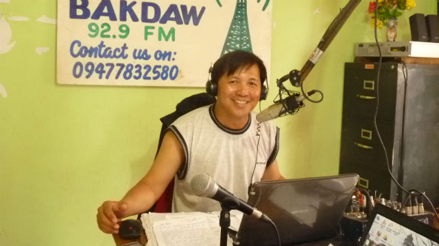 HUMANITARIAN RADIO. A radio announcer at this booth in Radyo Bakdaw in Guiuan, Eastern Samar