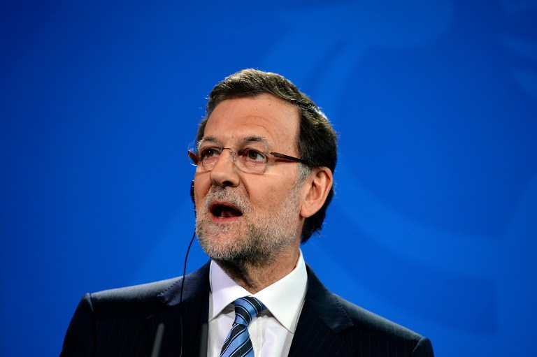 Spain's Prime Minister Mariano Rajoy addresses a press conference with the German Chancellor at the Chancellery in Berlin on February 4, 2013 after their meeting. AFP PHOTO / ODD ANDERSEN