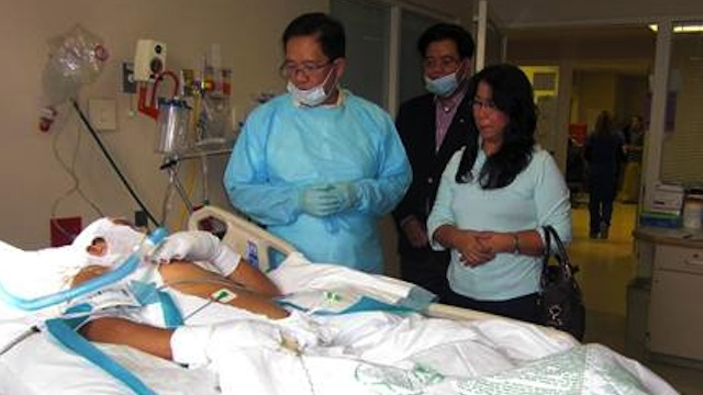 INJURED PINOYS RECOVERING WELL. Philippine Consul General in Chicago Leo Herrera-Lim (L) visits injured Filipino oil worker Renato Dominguez along with his wife in Baton Rouge, Louisiana. Photo courtesy of Philippine Embassy in Washington DC