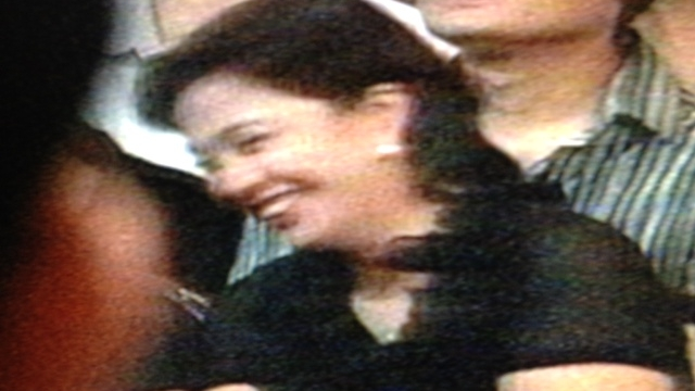 LIGHT MOMENTS. The late Jesse Robredo's wife, Leni, laughs while the Cabinet performs. Screen grab from Malacañang feed