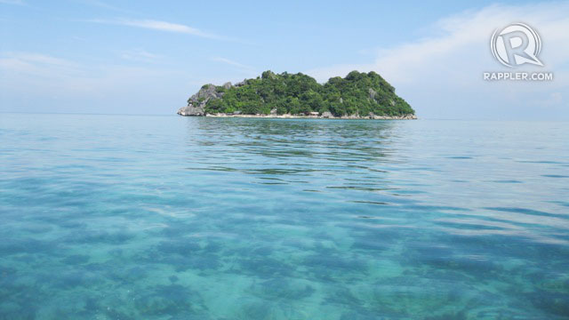 BLUER THAN BLUE. One of Islas de Gigantes' pristine islands. Photo by Kat Torres