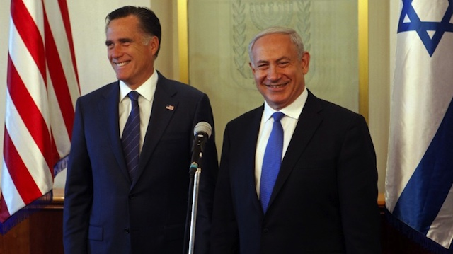 PAYBACK? Defeated US Republican presidential hopeful Mitt Romney shares a laugh with Israeli Prime Minister Benjamin Netanyahu (R) before a meeting at the premier's office in Jerusalem on July 29, 2012. AFP PHOTO/POOL/LIOR MIZRAHI