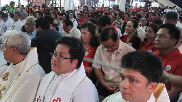 PRO-LIFE. Anti-Reproductive Health Bill advocates hear mass at St Peter's Parish in Quezon City. Photo by Angela Casauay