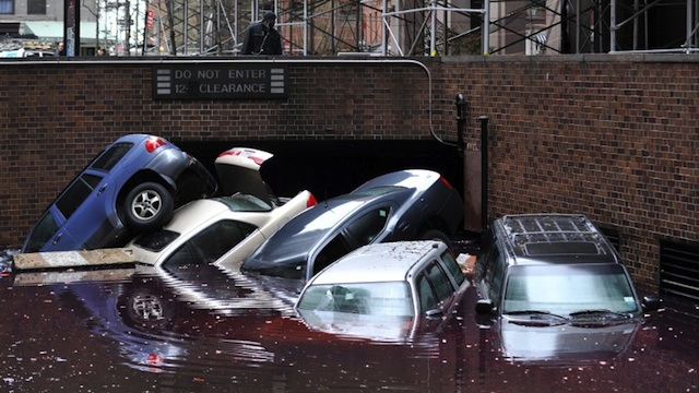 THOUSANDS HOMELESS. Cars piled on top of each other at the entrance to a garage on South Willliam Street in Lower Manhattan October 31, 2012 in New York as the city begins to clean up after Hurricane Sandy. AFP PHOTO/Stan HONDA