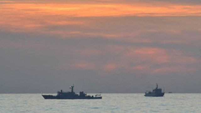 HISTORIC CASE. The Philippines is set to file its written pleading against China on March 30. File 2012 photo of Chinese surveillance ships off Scarborough Shoal by DFA/Philippine Navy/AFP